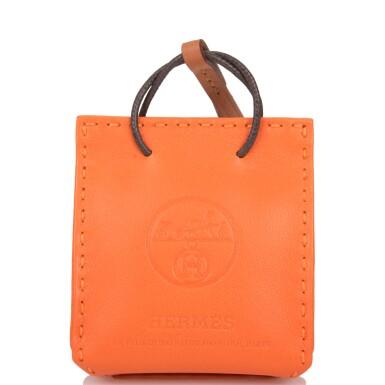 View 4. Thumbnail of Lot 100. Hermès Orange Bag Charm.