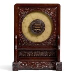 AN EXCEPTIONAL AND EXTREMELY RARE DATED ZITAN-MOUNTED ARCHAIC JADE DISC, BI ZHOU DYNASTY, THE INSCRIPTION AND THE STAND DATED TO 1775 | 清乾隆 御製紫檀嵌後刻御製詩古玉璧插屏 玉:《乾隆乙末春御題》款 「得佳趣」印 屏:《乾隆乙末春月御題》款 「得佳趣」印