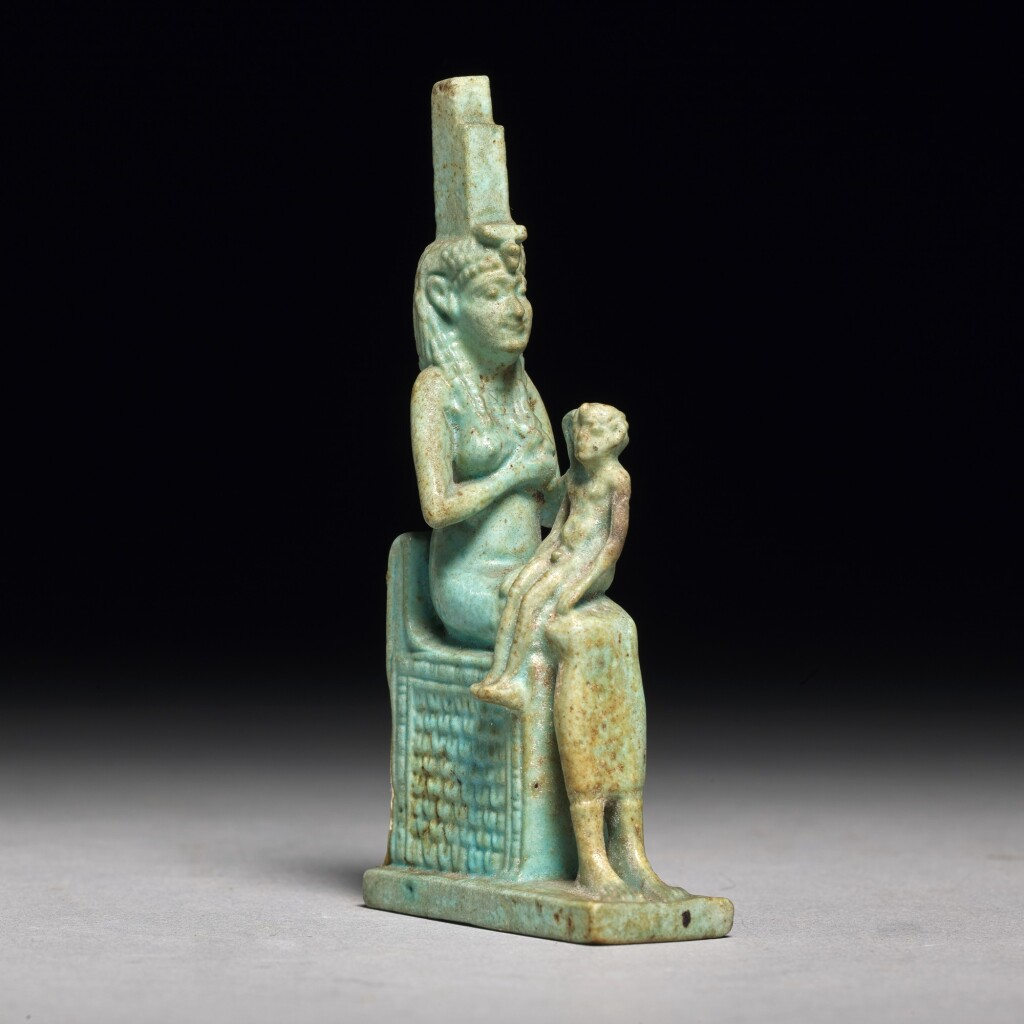 AN EGYPTIAN TURQUOISE FAIENCE FIGURE OF ISIS WITH HORUS, PTOLEMAIC PERIOD, 304-30 B.C.