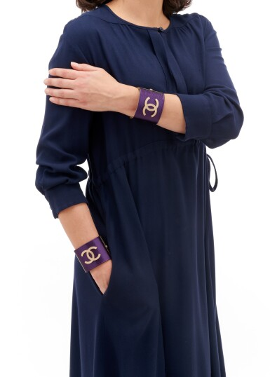 View 4. Thumbnail of Lot 83. Pair of purple leather wide cuffs.