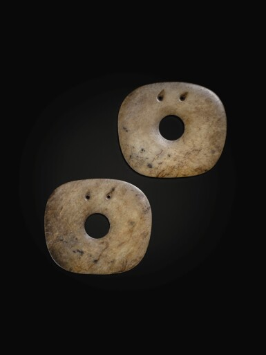 View 1. Thumbnail of Lot 75. A superb pair of calcified jade rounded square disc ornaments Neolithic period, Hongshan culture | 新石器時代 紅山文化方圓玉璧一對.