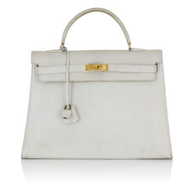 View 1. Thumbnail of Lot 12.  HERMÈS | WHITE VINTAGE KELLY SELLIER 32 IN VACHE LEATHER WITH GOLD HARDWARE, CIRCA 1960s.