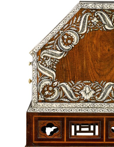 View 7. Thumbnail of Lot 246. An Anglo-Indian rosewood and ivory inlaid table bureau on a mahogany and fruitwood stand by Thomas Chippendale, the bureau, Vizagapatam, circa 1740-50, the stand, London, 1767.