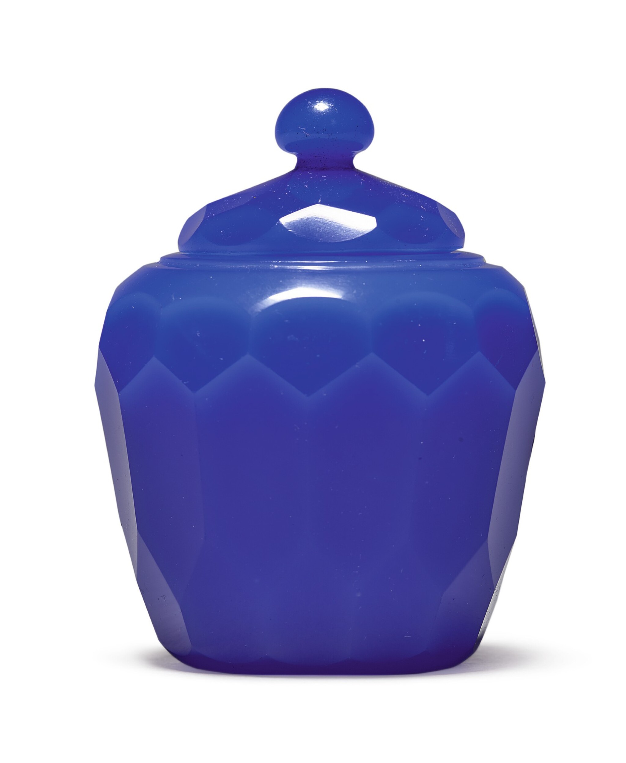 View 1 of Lot 1011. A FACETED ROYAL-BLUE GLASS JAR AND COVER, QING DYNASTY, 18TH CENTURY.