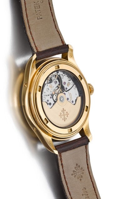 View 3. Thumbnail of Lot 8237. PATEK PHILIPPE | REFERENCE 5146   A YELLOW GOLD ANNUAL CALENDAR WRISTWATCH WITH MOON PHASES AND POWER RESERVE INDICATION, CIRCA 2008.