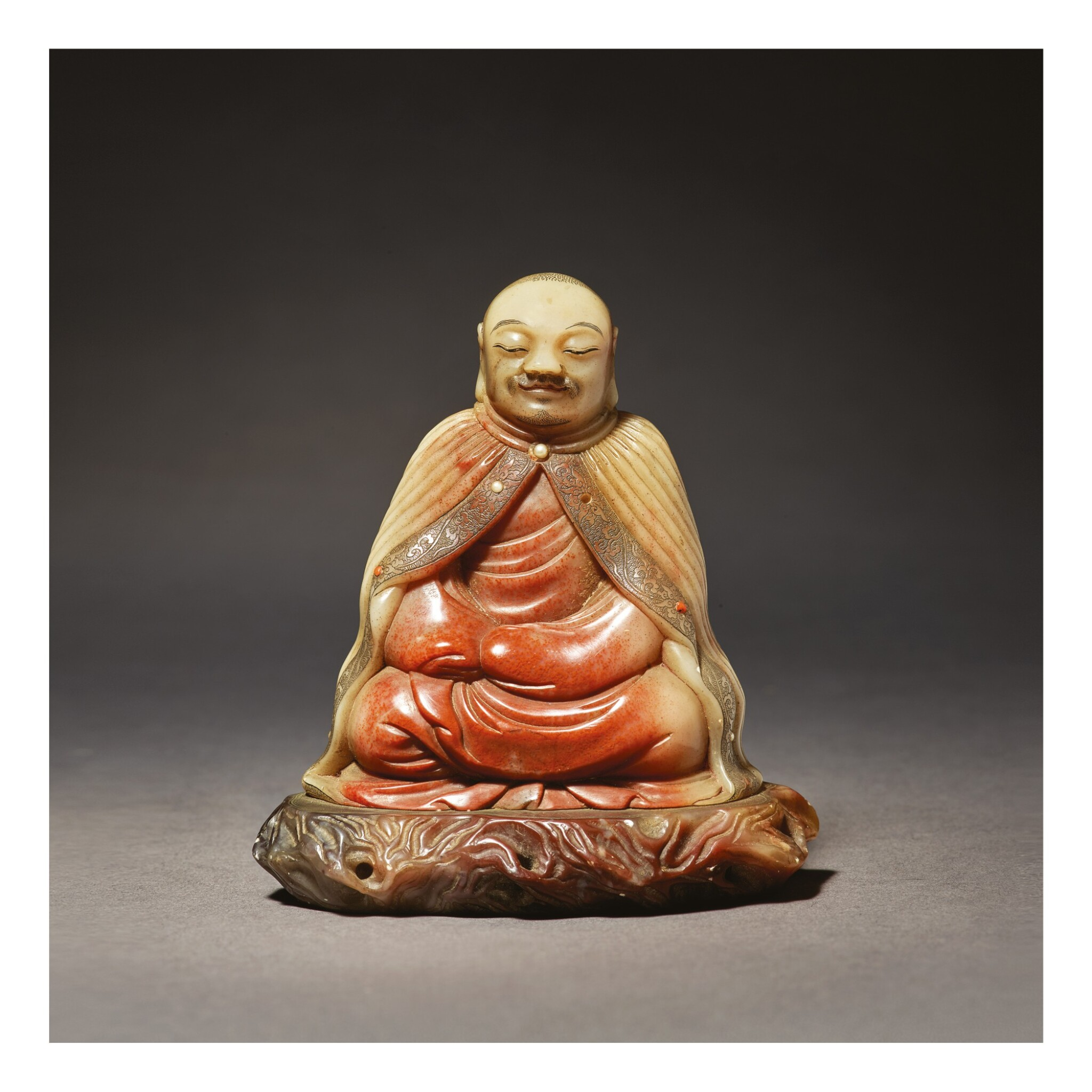 View full screen - View 1 of Lot 673. A SUPERB SOAPSTONE FIGURE OF A LUOHAN, ATTRIBUTED TO ZHOU BIN, 17TH / 18TH CENTURY.