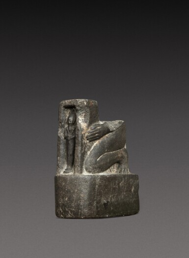 View 3. Thumbnail of Lot 47. A Fragmentary Egyptian Basalt Naophoros, 1st half of the 26th Dynasty, circa 664-600 B.C..