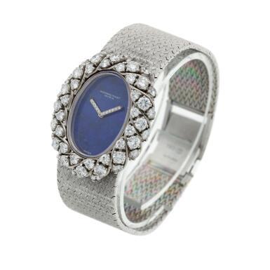 View 2. Thumbnail of Lot 158. A white gold and diamond-set bracelet watch with lapis lazuli dial, Circa 1980.