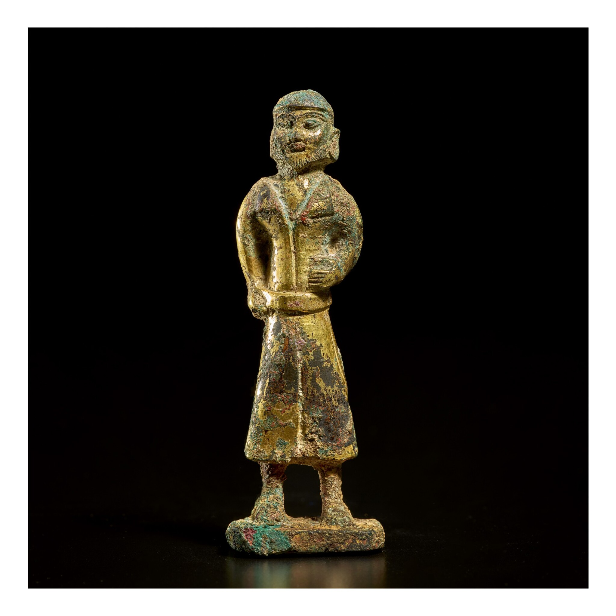 View full screen - View 1 of Lot 582. A GILT-BRONZE FIGURE OF A FOREIGN MERCHANT,  TANG DYNASTY.
