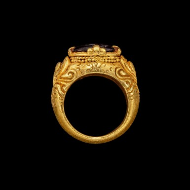 View 2. Thumbnail of Lot 1042. A gold repoussé ring with a garnet intaglio of a scorpion Khmer, 9th - 15th century | 九至十五世紀 高棉 金嵌石榴石凹雕蠍紋戒指.