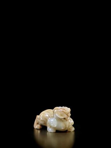 View 3. Thumbnail of Lot 46. A beige and russet jade bixie, Han - Six Dynasties | 漢至六朝 玉辟邪.