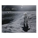 [APOLLO 16]. CHARLIE DUKE ON THE LUNAR SURFACE. COLOR PHOTOGRAPH, SIGNED AND INSCRIBED BY CHARLIE DUKE