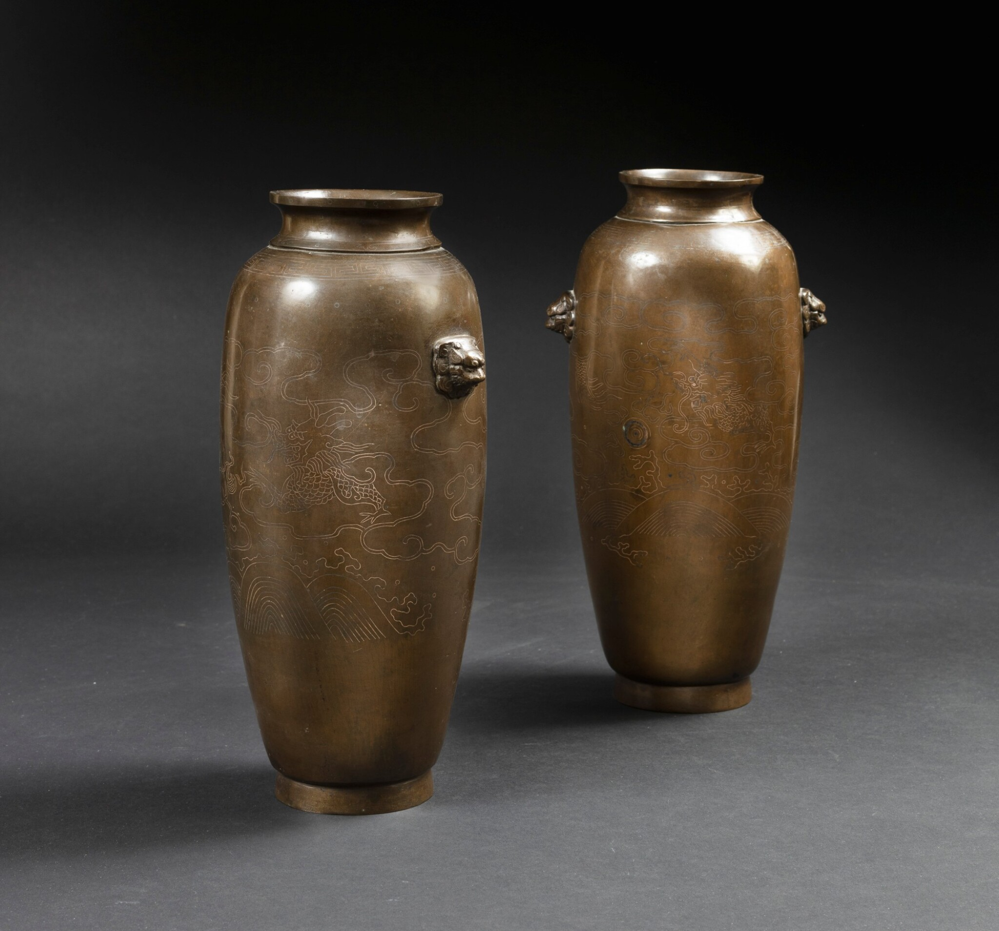 View full screen - View 1 of Lot 122. A extremely rare pair of bronze 'Shisou' ovoid 'dragon' vases Qing dynasty, 17th-18th century | 清十七至十八世紀 銅錯銀龍紋獅首耳瓶一對  《石叟》款.