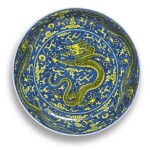 A FINE YELLOW-ENAMELED AND BLUE-GROUND 'DRAGON' DISH,  KANGXI MARK AND PERIOD