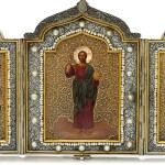A PARCEL-GILT GOLD, SILVER AND PEARL-SET TRIPTYCH ICON, OLOVYANISHNIKOV AND SONS, MOSCOW, 1908-1917