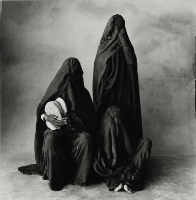 View 1. Thumbnail of Lot 41. IRVING PENN | THREE RISSANI WOMEN WITH BREAD, MOROCCO, 1971.