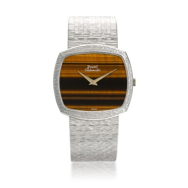 PIAGET | REF 12731 A6, WHITE GOLD BRACELET WATCH WITH TIGER'S EYE DIAL CIRCA 1990