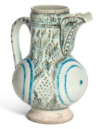 A KUTAHYA POTTERY JUG WITH MOULDED DECORATION, TURKEY, 18TH CENTURY