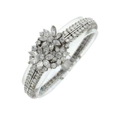 View 3. Thumbnail of Lot 96. A lady's platinum diamond set cocktail wristwatch on diamond link bracelet, Circa 1960.