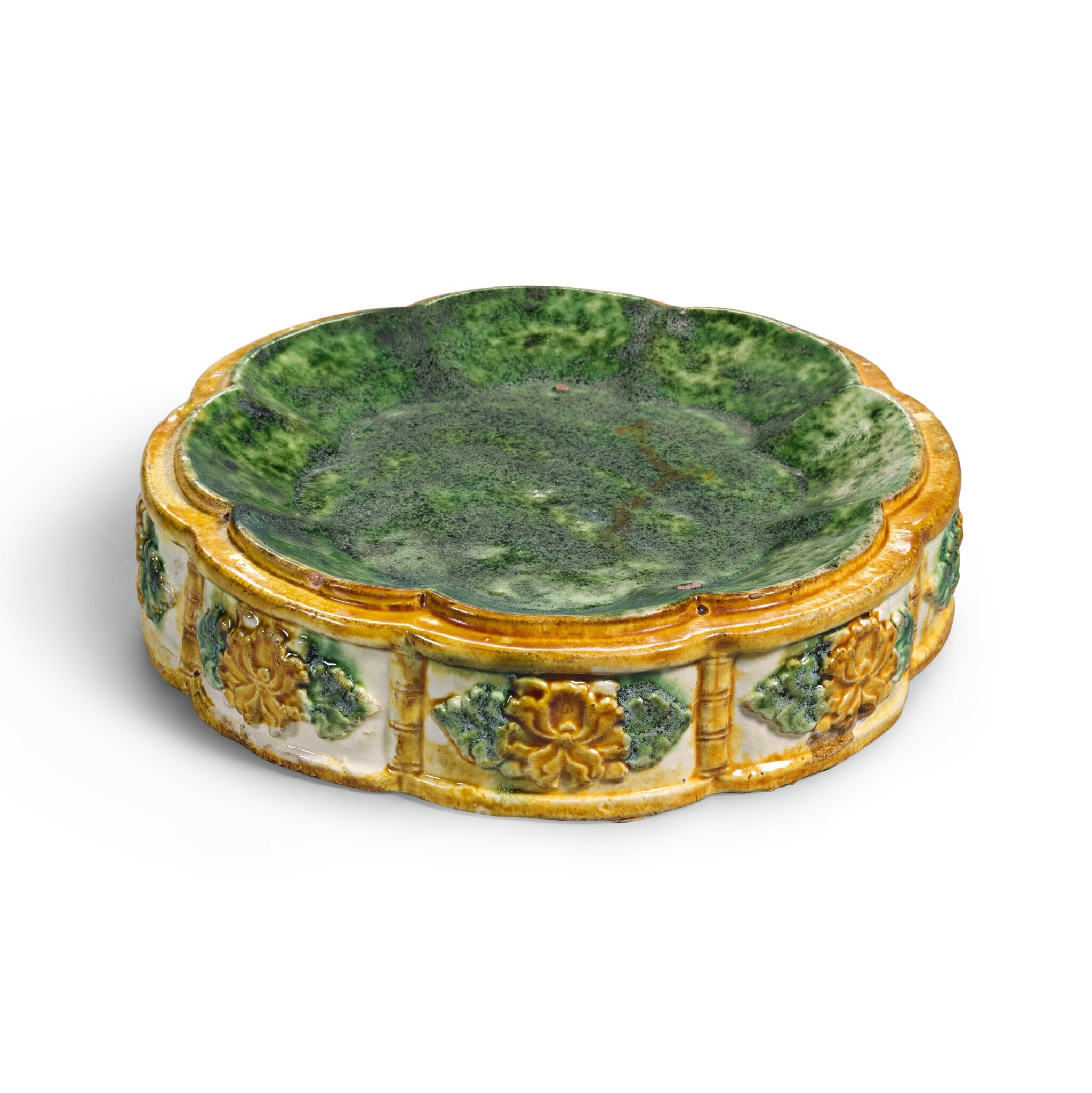 View full screen - View 1 of Lot 233. A RARE SANCAI-GLAZED OCTAFOIL STACKING DISH, LATE TANG DYNASTY | 晚唐 三彩模印花口套盤.