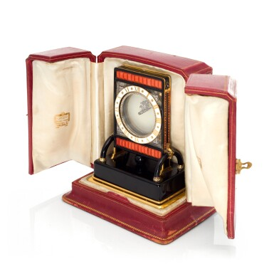 View 1. Thumbnail of Lot 93. PENDULE ECRAN AN IMPORTANT AND RARE ROCK CRYSTAL, ONYX, ENAMEL, CORAL, YELLOW GOLD AND DIAMOND-SET MYSTERY DESK TIMEPIECE, CIRCA 1926.