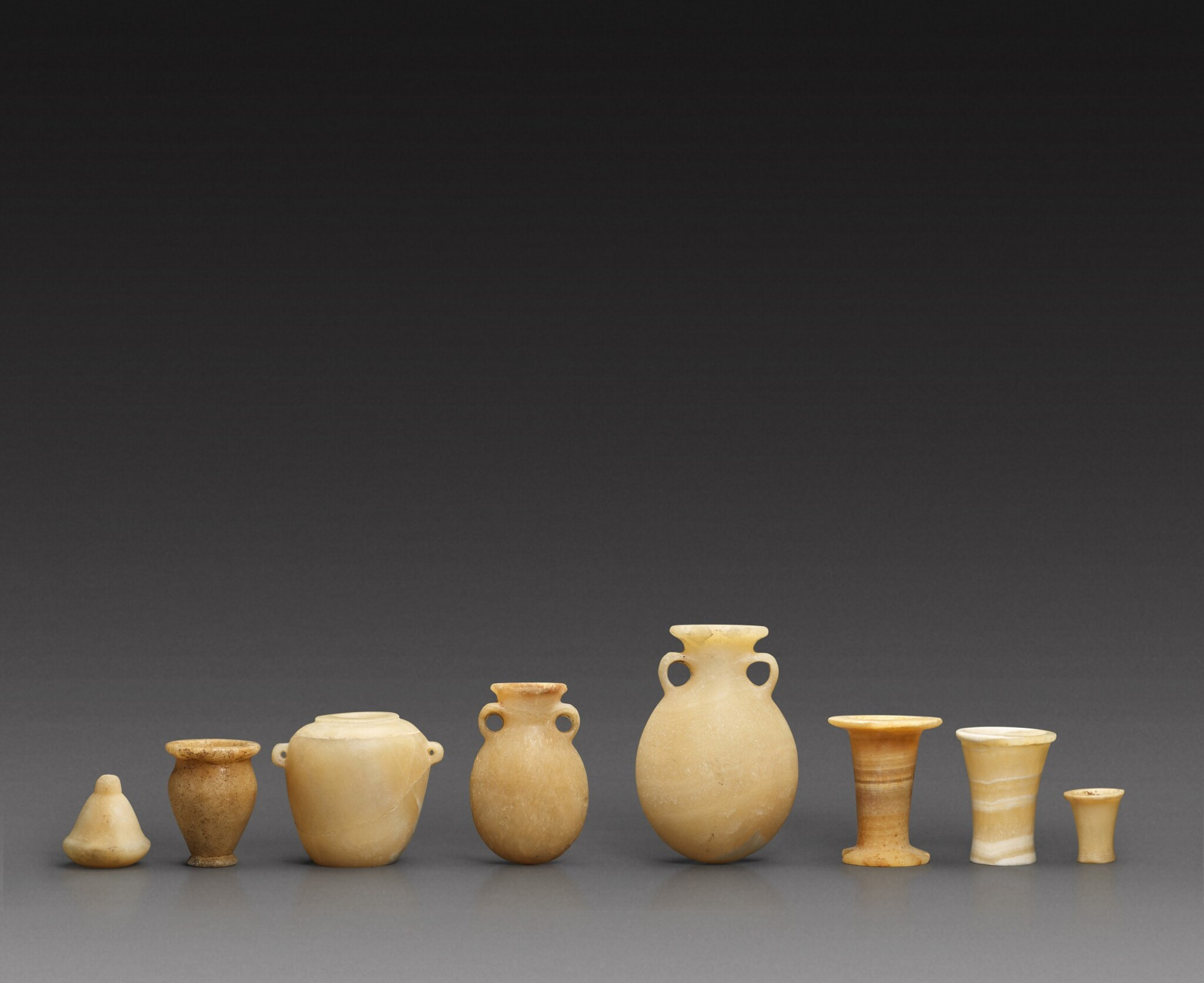 View full screen - View 1 of Lot 72. Eight Egyptian Alabaster Miniature Vessels, 3rd/2nd Millennium B.C..