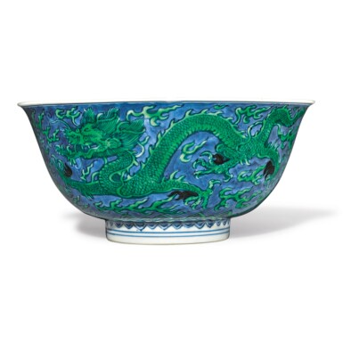View 1. Thumbnail of Lot 560. A BLUE-GROUND GREEN-ENAMELED 'DRAGON' BOWL,  KANGXI MARK AND PERIOD.