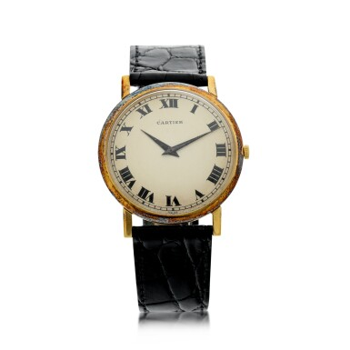 View 1. Thumbnail of Lot 71. RETAILED BY CARTIER: A YELLOW GOLD WRISTWATCH, CIRCA 1970.