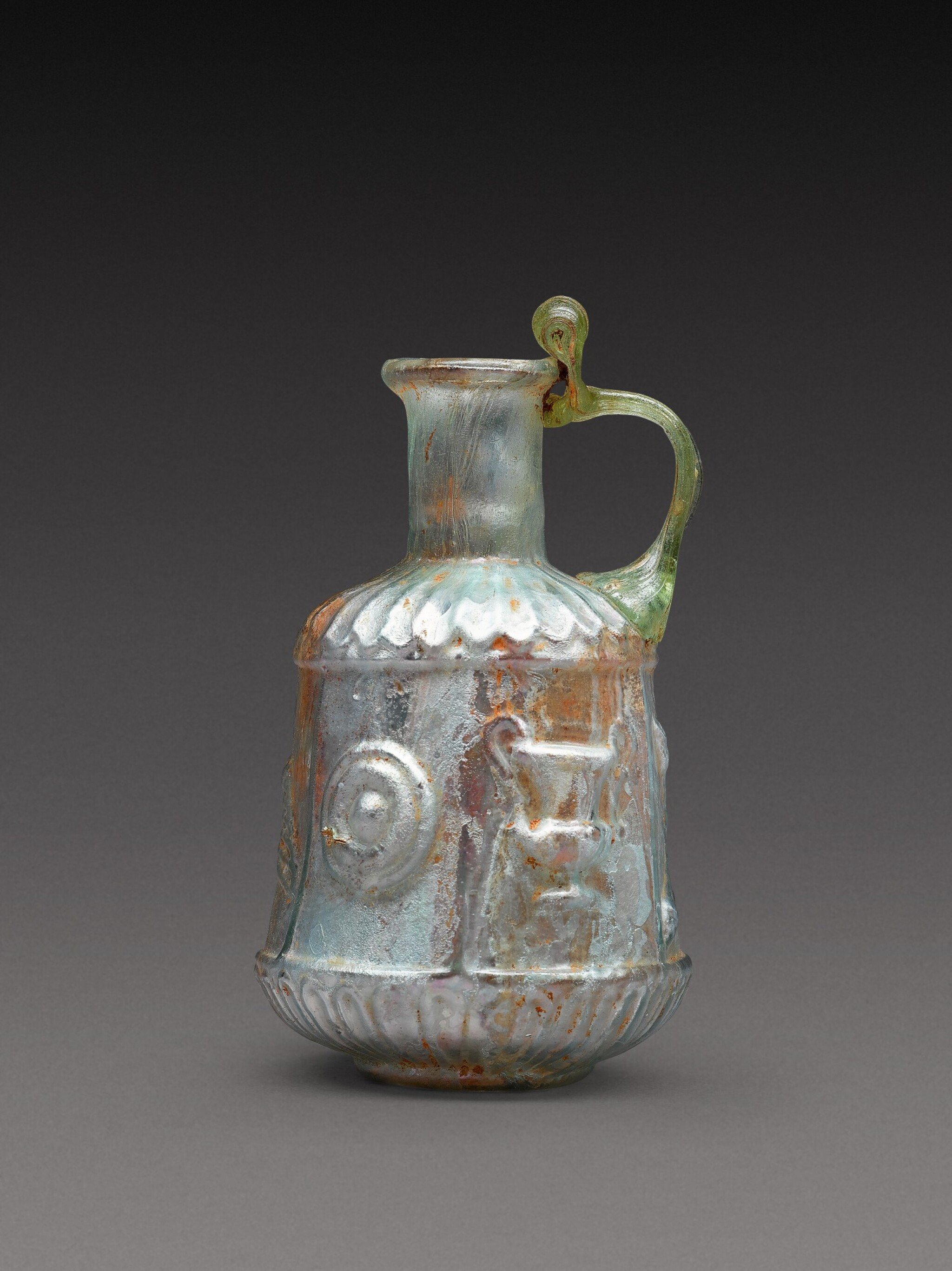 View full screen - View 1 of Lot 4. A Roman Pale Green Mould-Blown Glass Flask, circa 1st century A.D..