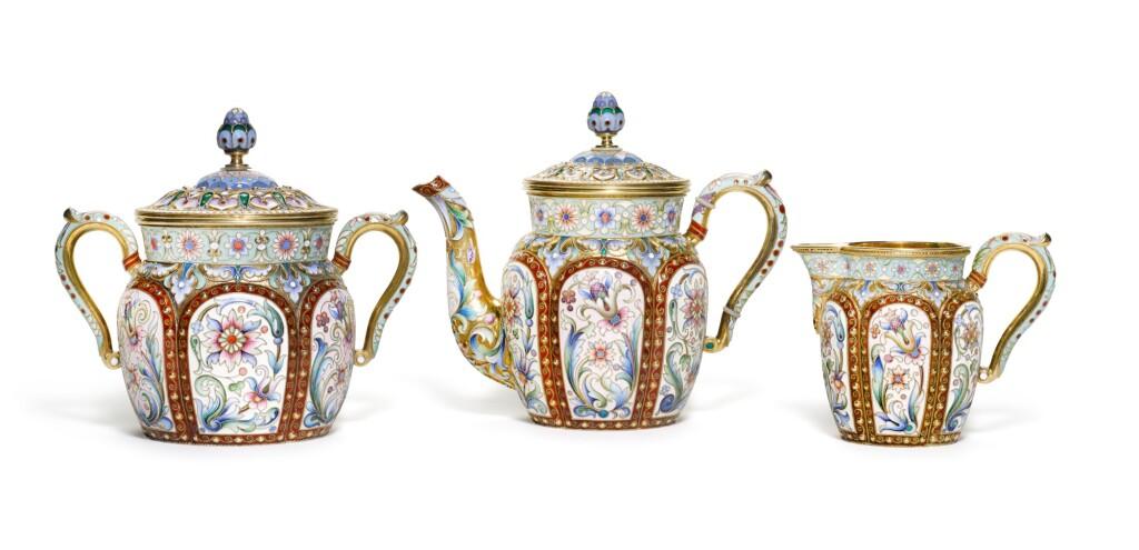 A SILVER-GILT AND CLOISONNÉ ENAMEL THREE-PIECE TEA SET, PAVEL OVCHINNIKOV, MOSCOW, 1899-1908