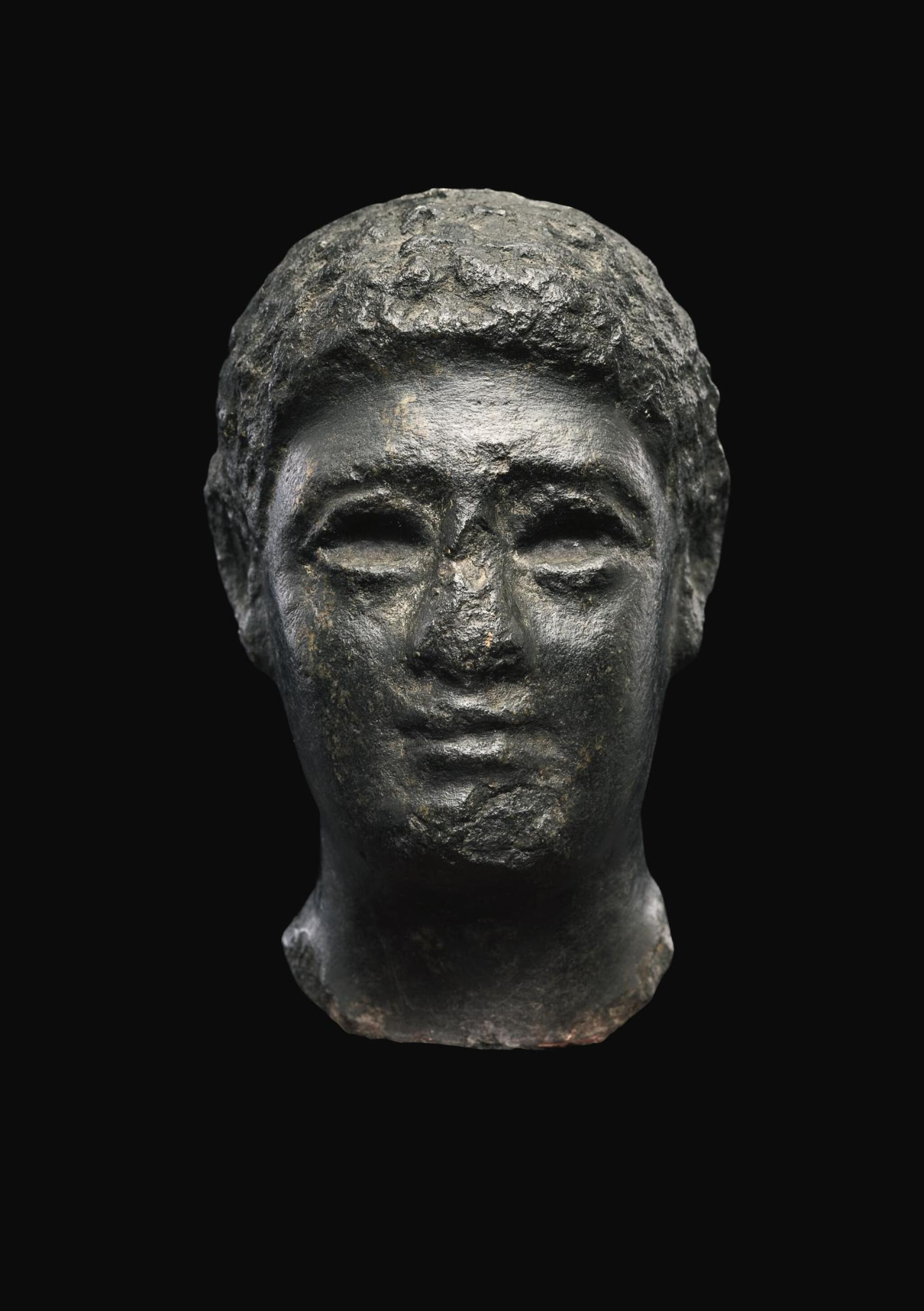 View full screen - View 1 of Lot 55. AN EGYPTIAN BASALT HEAD OF A MAN, LATE PTOLEMAIC PERIOD, CIRCA 100-30 B.C..