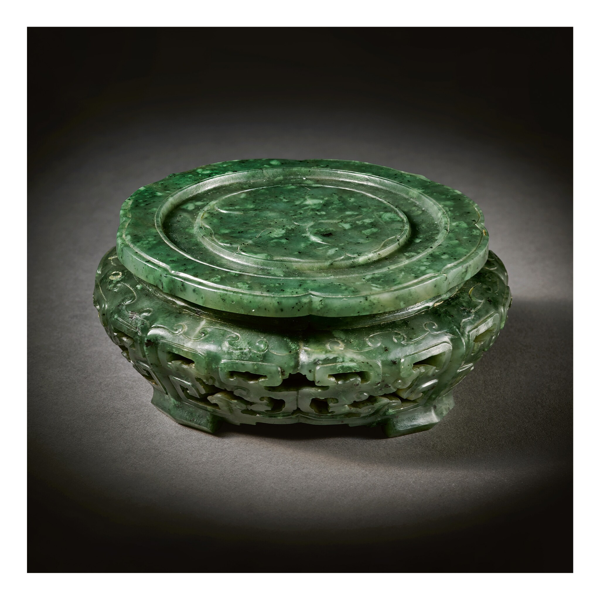 View full screen - View 1 of Lot 233. A RARE IMPERIAL SPINACH-GREEN JADE STAND,  QING DYNASTY, QIANLONG PERIOD.