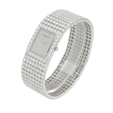 View 4. Thumbnail of Lot 60. Kalla, Ref. 35704-707G White gold and diamond-set bracelet watch Made in 1990 | 江詩丹頓35704-707G型號「Kalla」白金鑲鑽石鍊帶腕錶,1990年製.