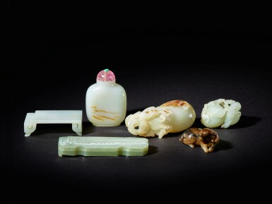 View 6. Thumbnail of Lot 88. A white jade 'bat, peach, water chestnut and prunus' group, Qing dynasty, 18th / 19th century.