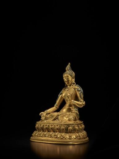 View 2. Thumbnail of Lot 107. A Tibeto-Chinese gilt-bronze figure of White Tara, Circa 1700 | 約1700年 藏傳銅鎏金白度母坐像.