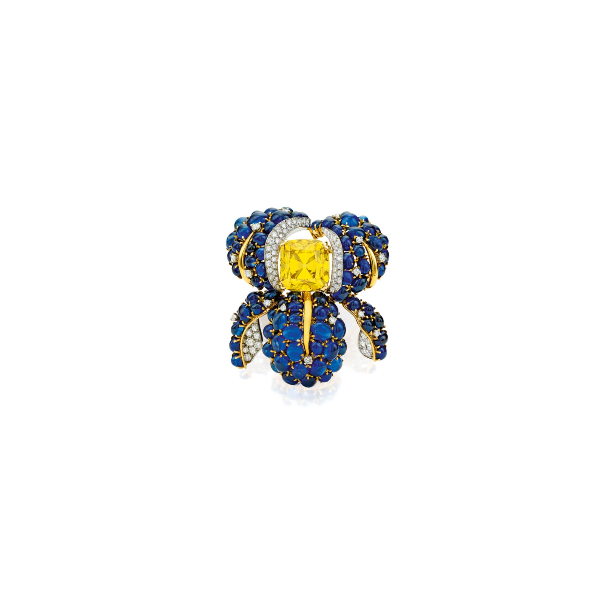 View full screen - View 1 of Lot 497. AN EXCEPTIONAL FANCY VIVID YELLOW DIAMOND, DIAMOND AND SAPPHIRE CLIP-BROOCH, VERDURA   艷彩黃色鑽石配鑽石及藍寶石別針一枚,Verdura.