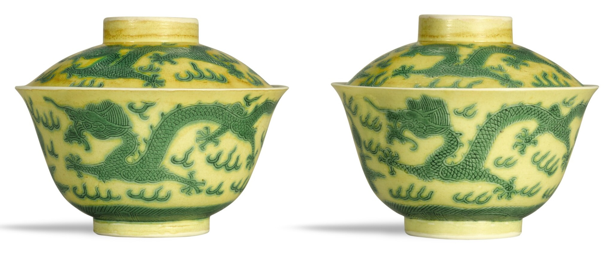 View full screen - View 1 of Lot 335. A PAIR OF YELLOW-GROUND GREEN-ENAMELLED 'DRAGON' BOWLS AND COVERS GUANGXU MARKS AND PERIOD   清光緒 黃地綠彩趕珠游龍紋蓋盌一對 《大清光緒年製》款.