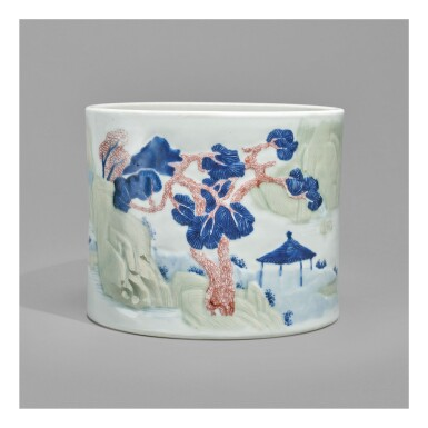 View 1. Thumbnail of Lot 125. AN UNDERGLAZE-BLUE, COPPER-RED, AND CELADON-GLAZED 'LANDSCAPE' BRUSHPOT,   KANGXI MARK AND PERIOD.