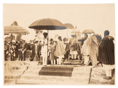 View 3. Thumbnail of Lot 157. Ethiopia | Album of photographs and press cuttings relating to the Coronation of Haile Selassie, November 1930.