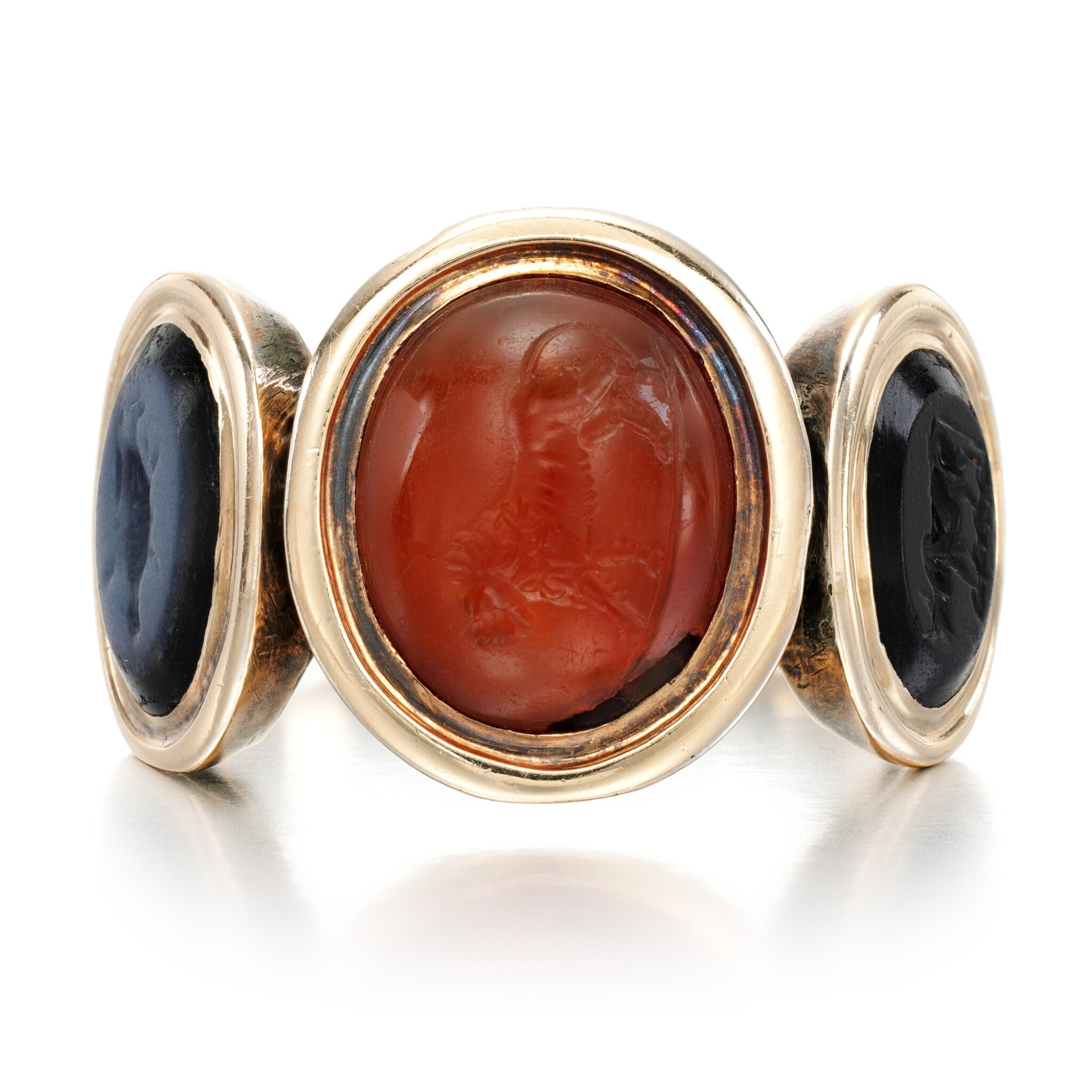 View full screen - View 1 of Lot 125. Carnelian and onyx intaglio ring, late 18th century.