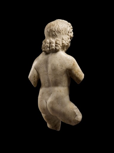 View 4. Thumbnail of Lot 74. A Roman Marble Figure of Eros, circa 1st Century B.C..
