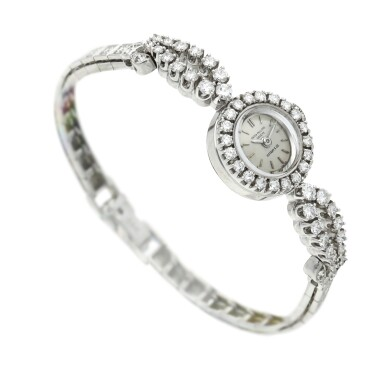 View 3. Thumbnail of Lot 157.  Retailed by Tiffany & Co.: A platinum and diamond-set bracelet watch, Circa 1950.