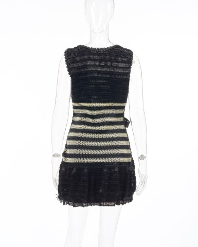 View 3. Thumbnail of Lot 4. Black and off-white striped vinyl dress and ribbon bow brooch.