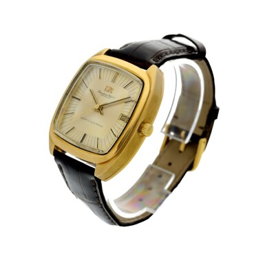 View 2. Thumbnail of Lot 92. REFERENCE R3003 A YELLOW GOLD TONNEAU SHAPED WRISTWATCH WITH DATE, CIRCA 1970.