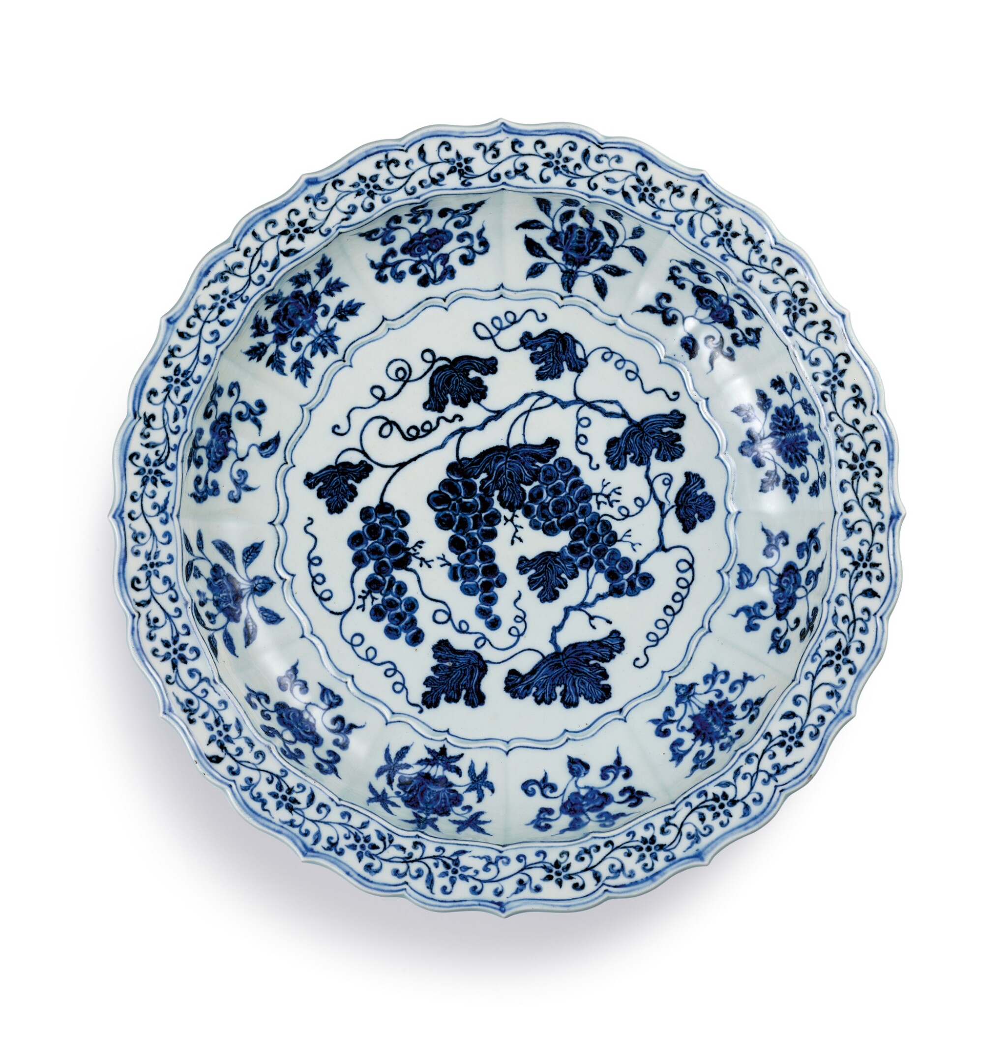 View full screen - View 1 of Lot 3612. An exceptional and rare blue and white barbed 'grape' charger Ming Dynasty, Yongle Period | 明永樂 青花葡萄紋折沿菱口盤.