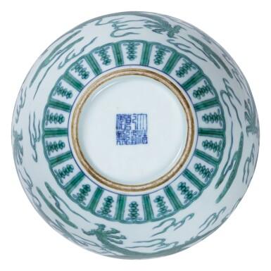 View 5. Thumbnail of Lot 13. DEUX JARRES COUVERTES EN PORCELAINE BLEU BLANC ÉMAILLÉE VERT MARQUES ET ÉPOQUE QIANLONG   清乾隆 青花綠釉龍紋蓋罐兩件 《大清乾隆年製》款   Two green-enamelled 'dragon' jars and covers, Qianlong seal marks and period .