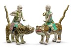 Two Extremely Rare Chinese Export Famille-verte Glazed Biscuit Figures of Luohan and Tigers, Qing Dynasty, Kangxi Period   清康熙  素三彩伏虎羅漢兩尊