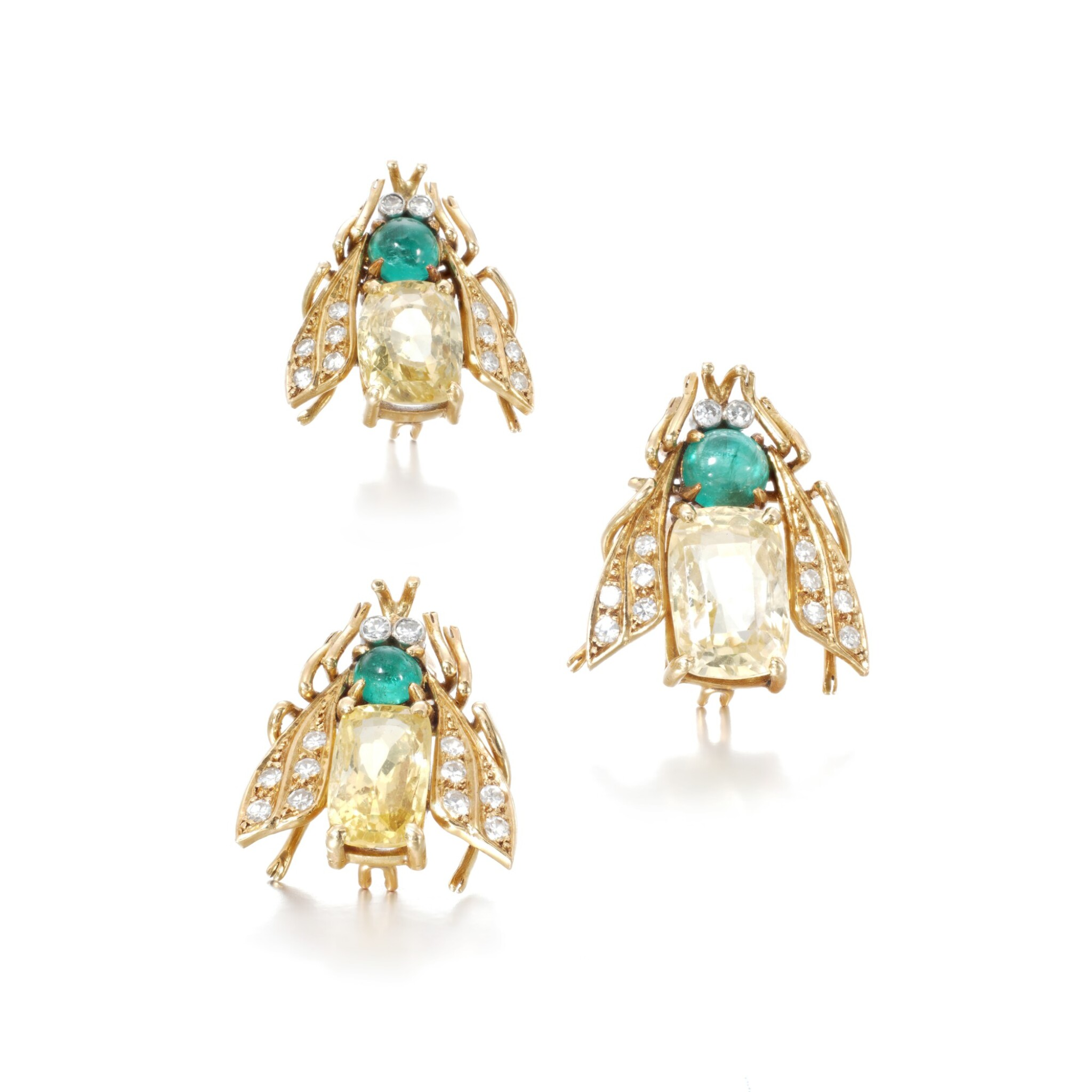 View full screen - View 1 of Lot 39. Three yellow sapphire, emerald and diamond brooches.