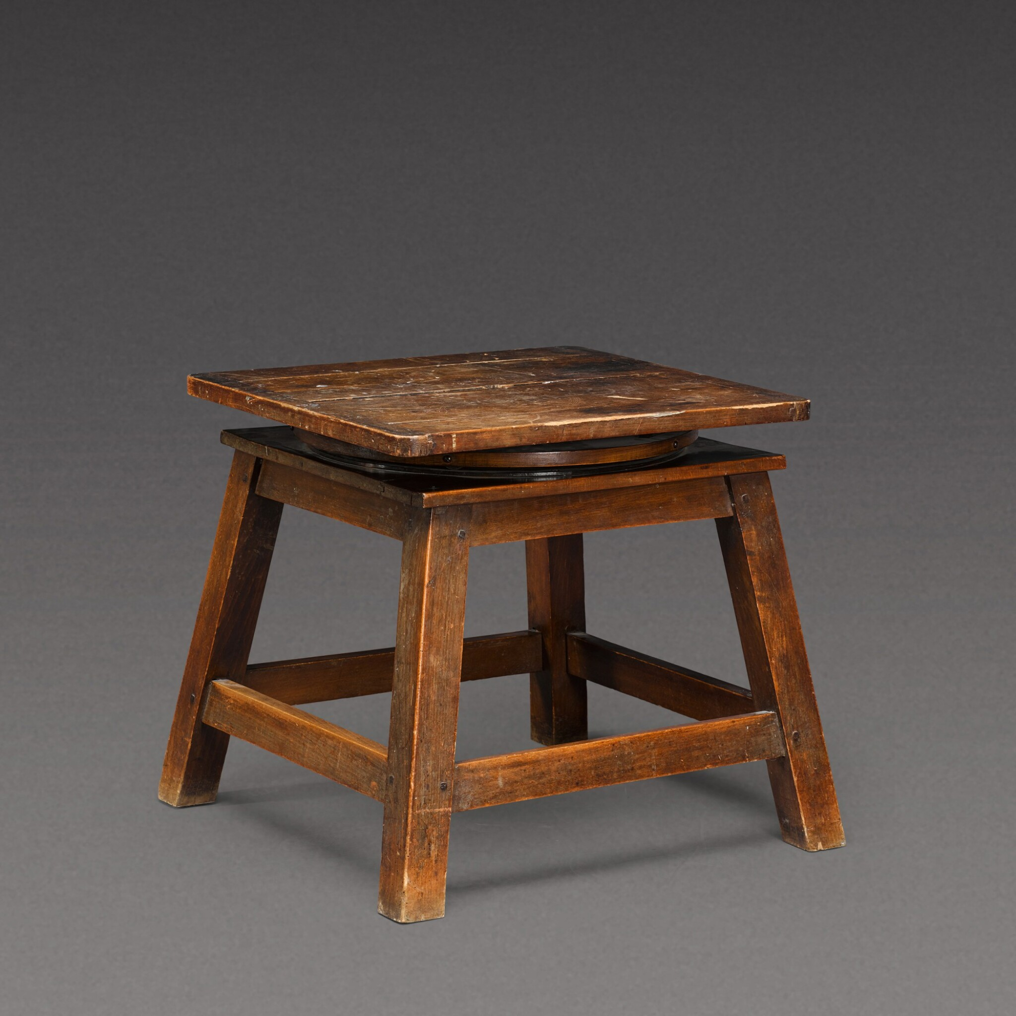 View 1 of Lot 175. A sculptor's walnut tripod low stand, probably French, early 20th century.