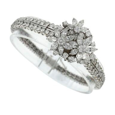 View 4. Thumbnail of Lot 96. A lady's platinum diamond set cocktail wristwatch on diamond link bracelet, Circa 1960.